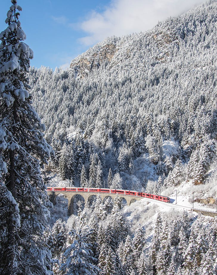 a train moving through europe in winter