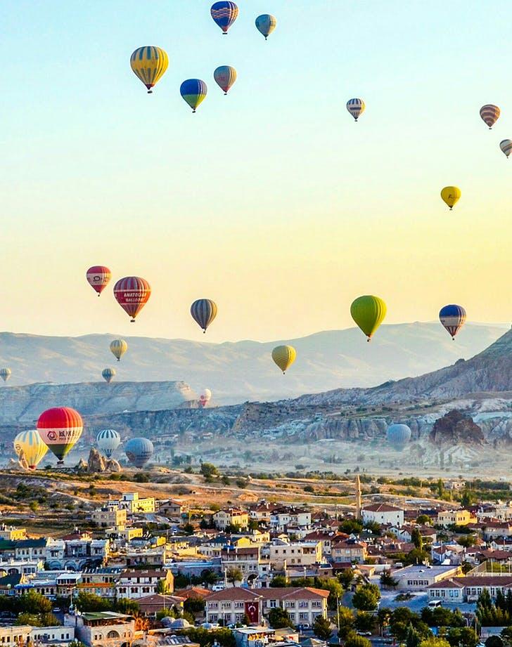 hot air balloons flying over cappadocia
