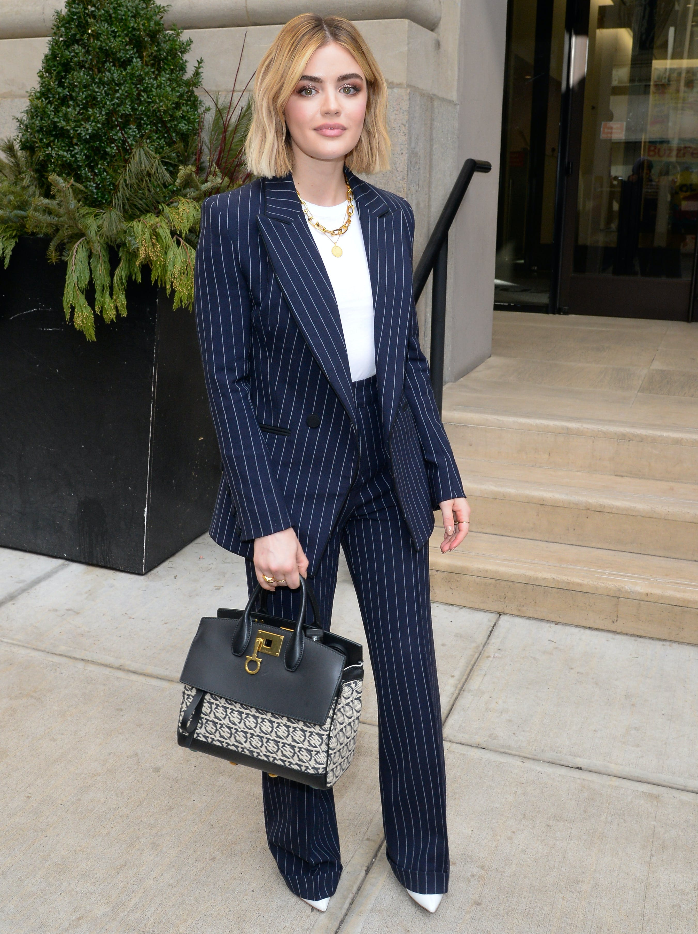 lucy hale wearing a pinstripe suit
