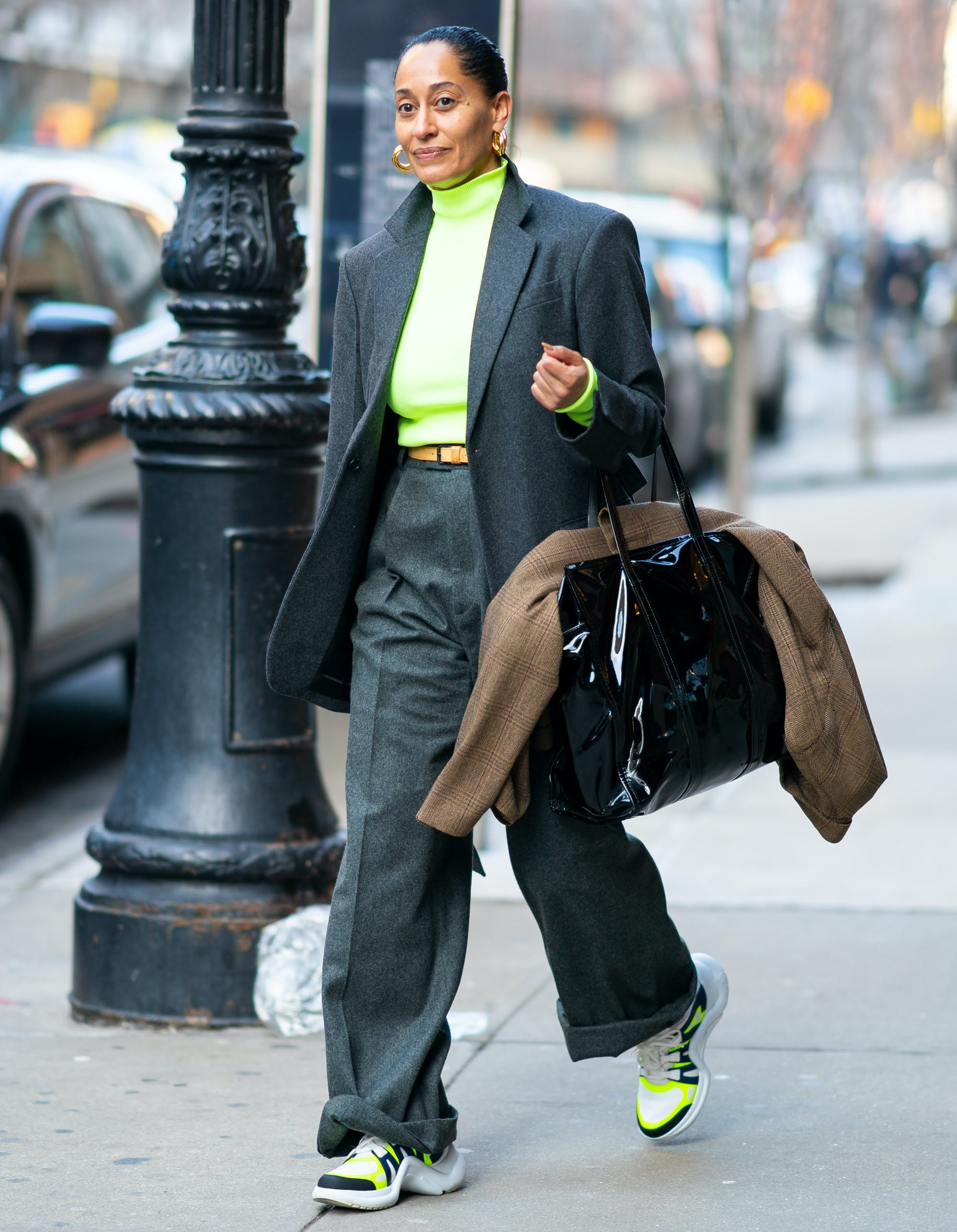 tracee ellis ross wearing a gray suit with neon