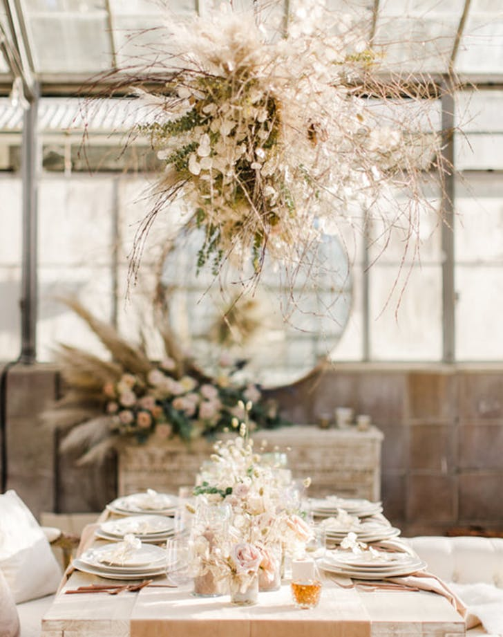using pamas grass as a chandelier at a wedding