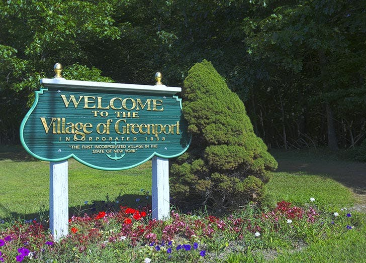 welcome to the village of greenport sign