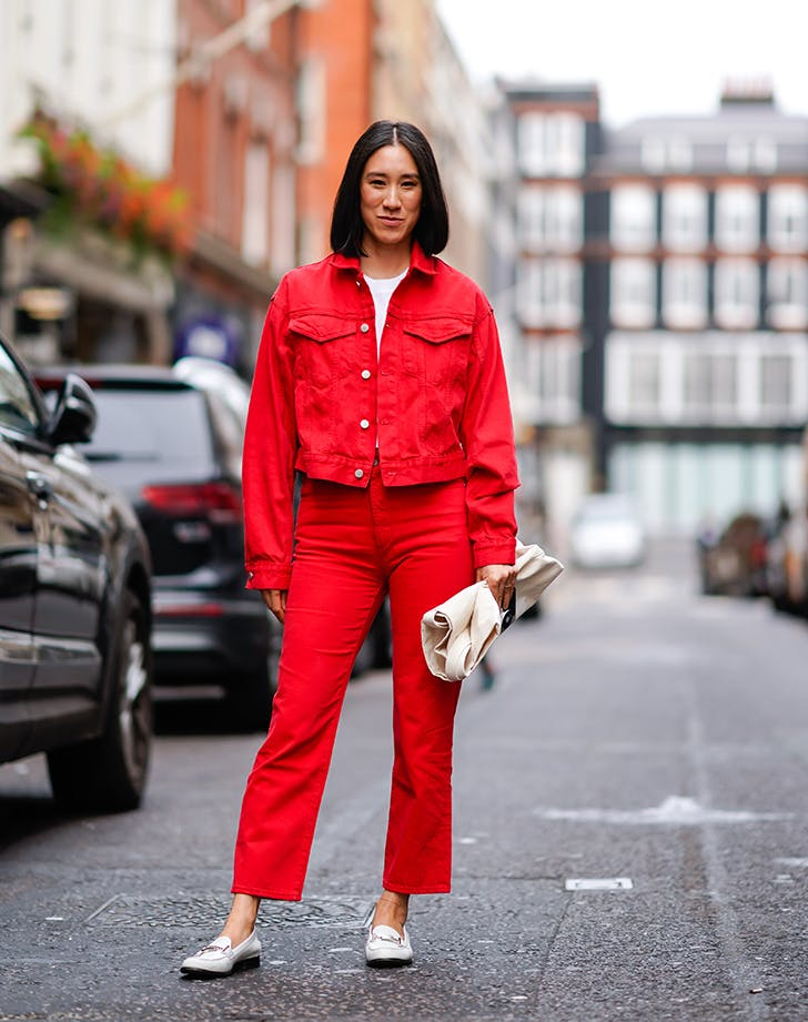 woman wearing a red denim jacket and red jeans