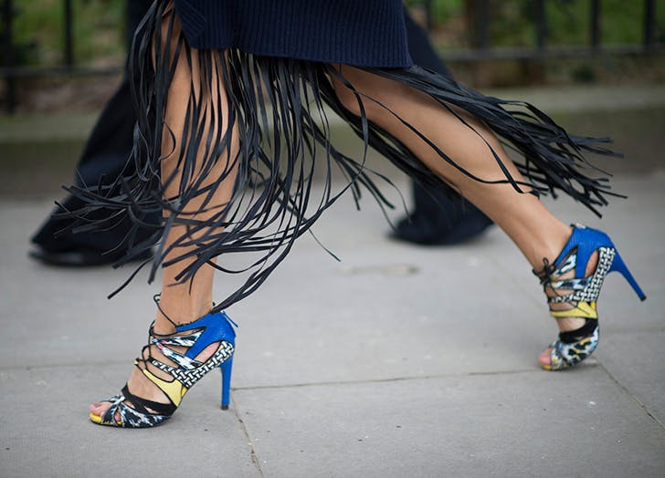 woman wearing fringe skirt and colorful heels