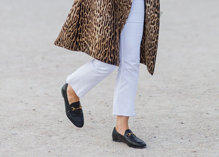 woman wearing polished loafers and white pants