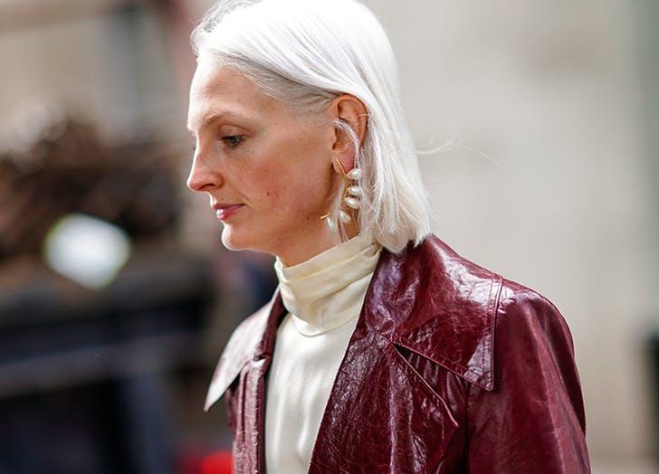 woman wearing baroque pearl earrings