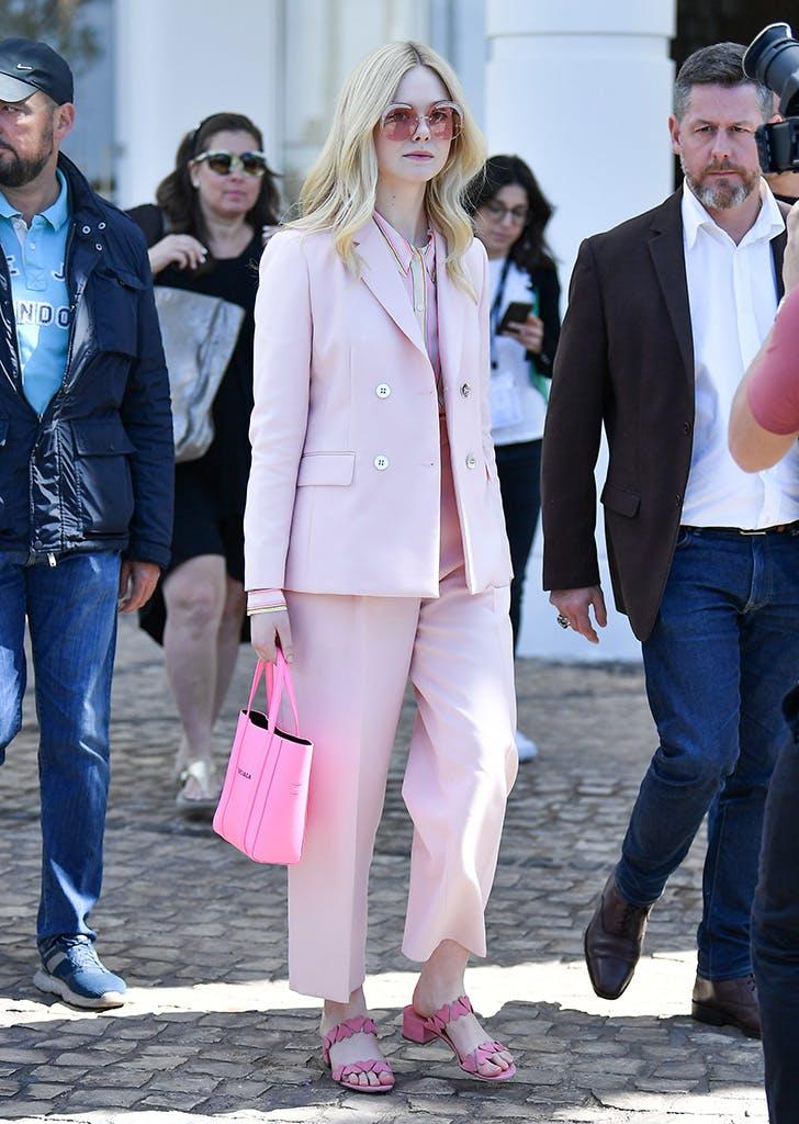 elle fanning wearing a pink suit