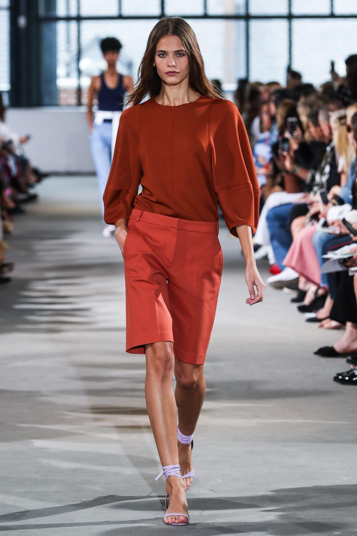 model at tibi wearing bermuda shorts