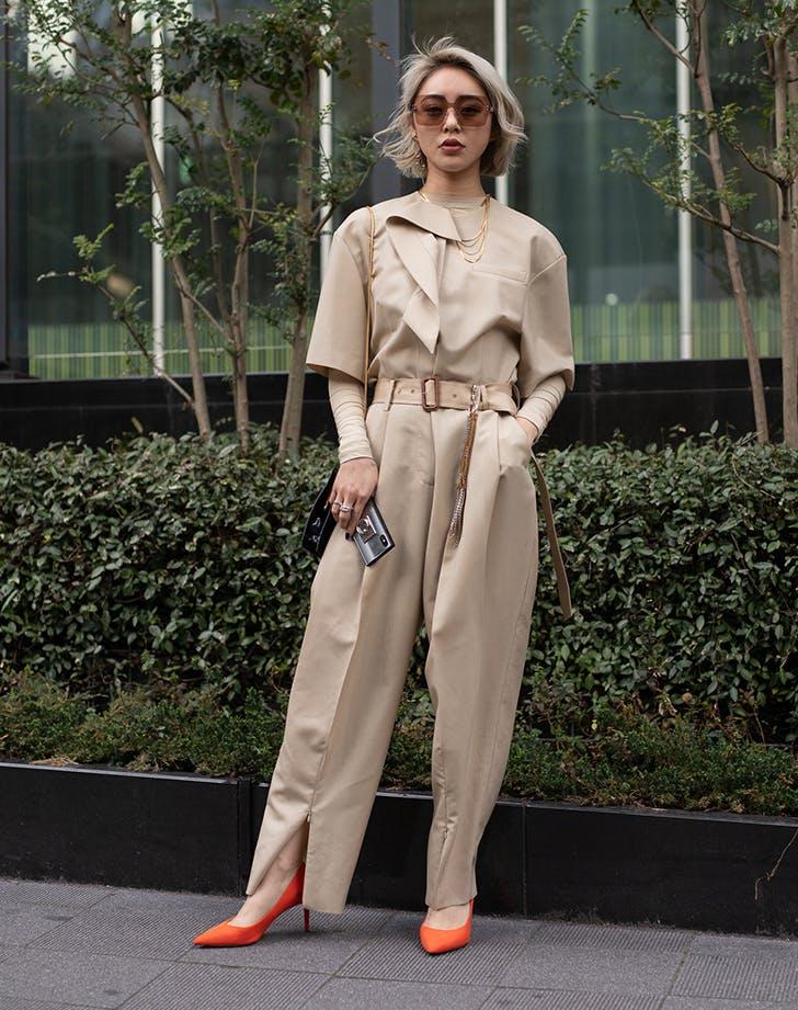 woman wearing a beige boilersuit