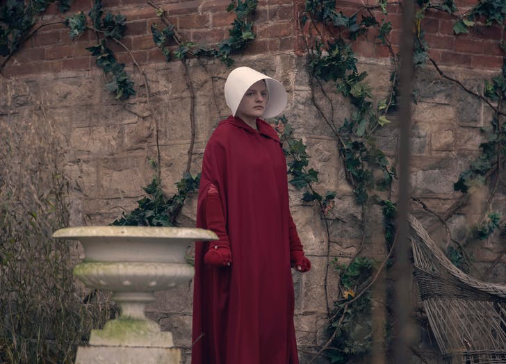 June walking in garden handmaids tale