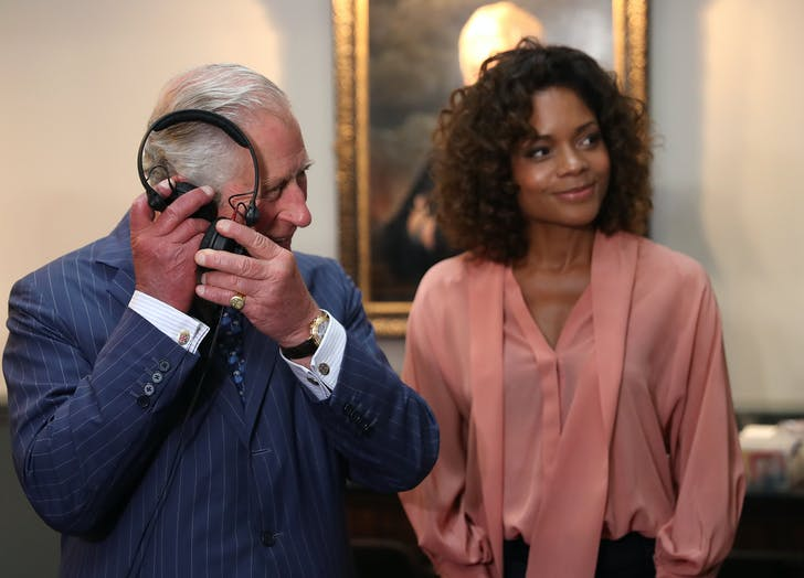 Prince Charles Naomie Harrison on set with headphones