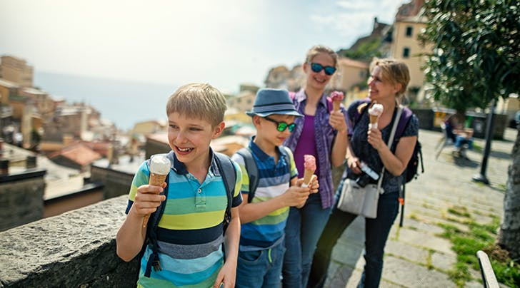 kids and parents eating ice cream in italy