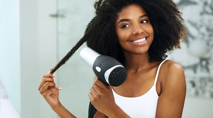 How To Straighten Natural Hair And Avoid Damage Purewow