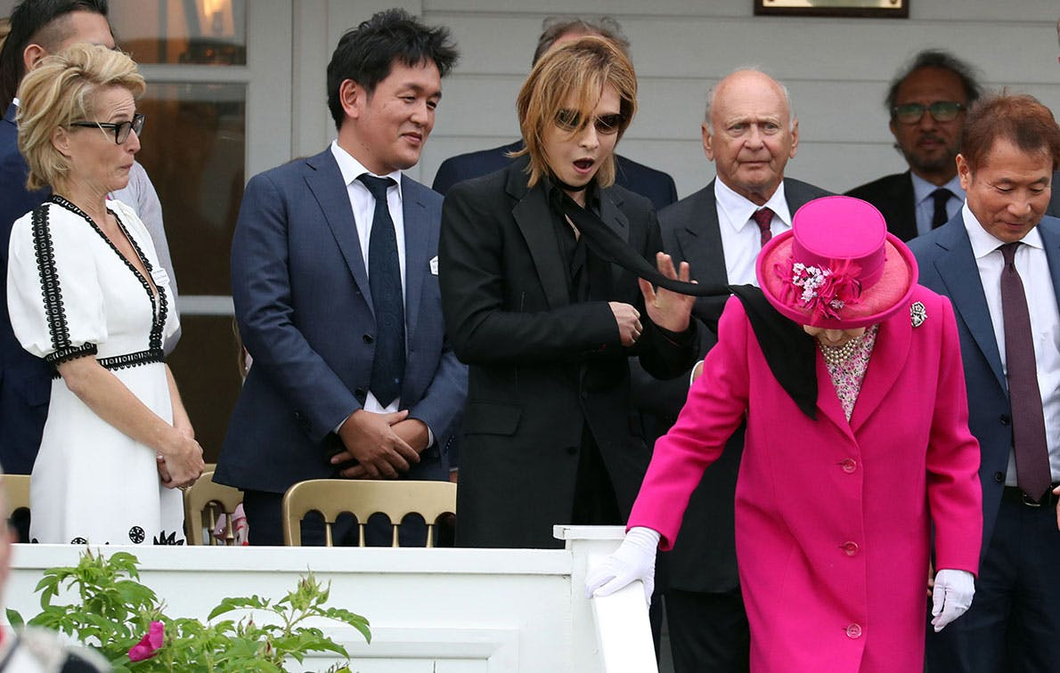Queen Elizabeth Battled a Scarf That Flew into Her Face at a Polo Match This Weekend, but She Kept Calm and Carried on