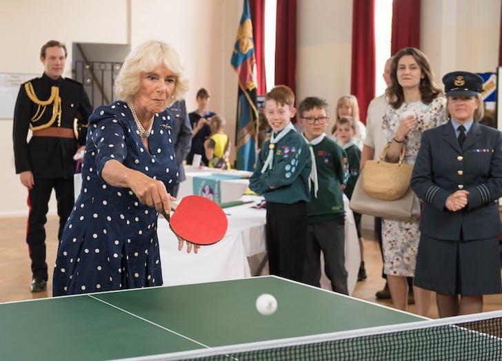 Camilla parker bowles lobbing a ping pong serve