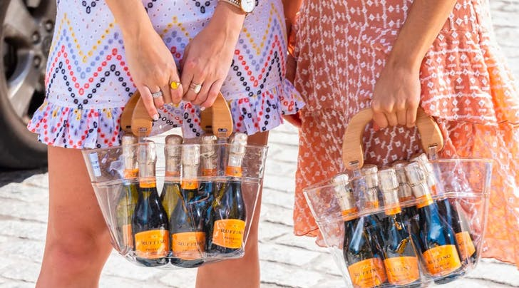 These Prosecco Purses Hold a 6-Pack of Bubbly and Are Actually Kinda Cute