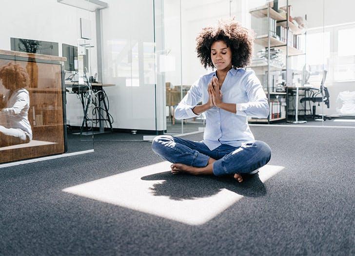 woman meditating on floor