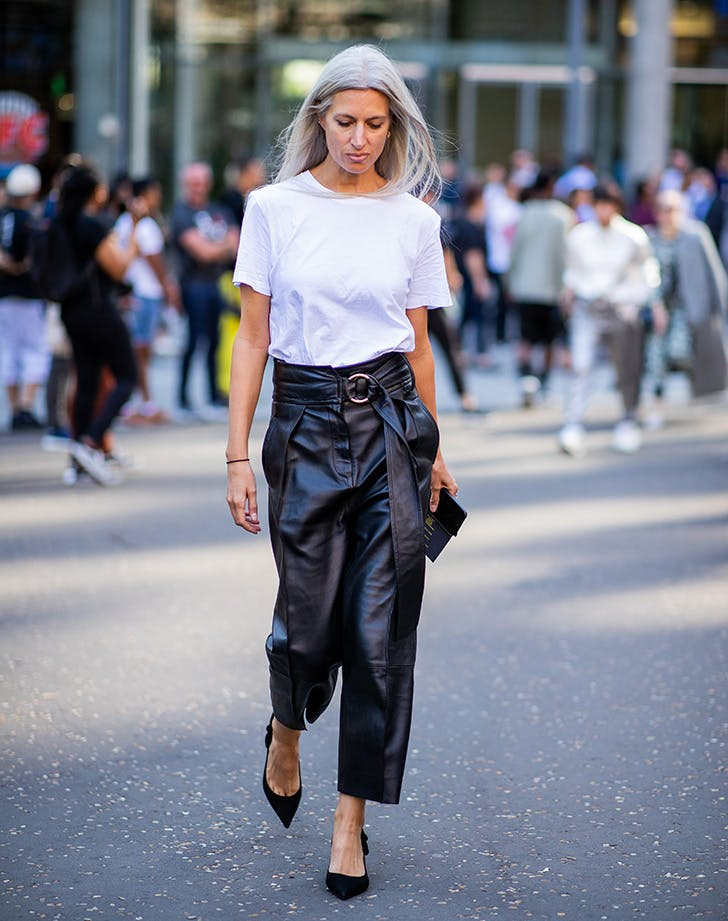 woman wearing a white tshirt and black pants