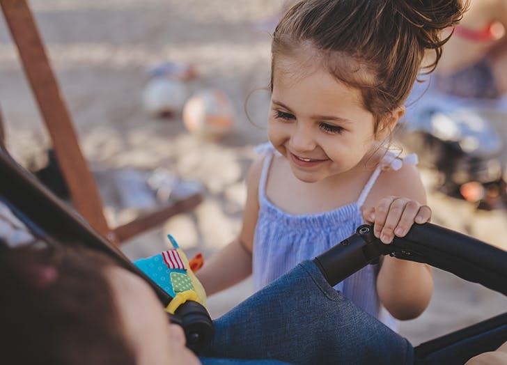 baby in stroller at beach