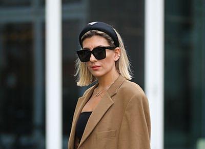 blonde woman wearing headband hero