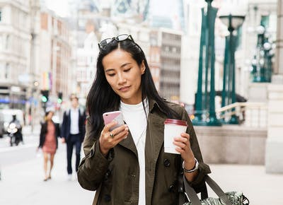 woman texting phone travel