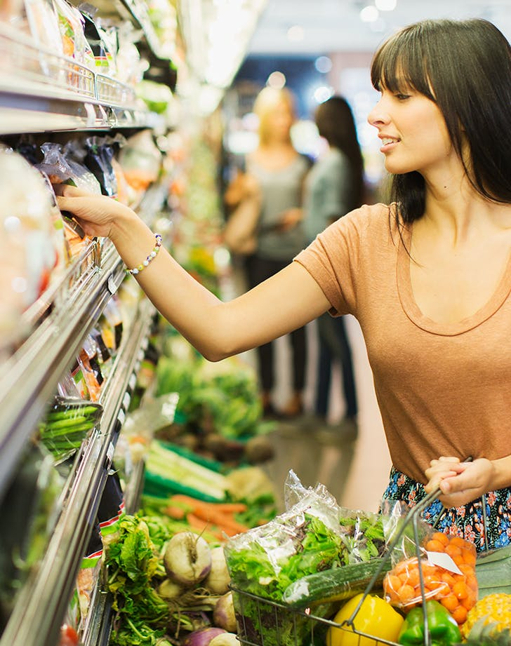 woman grocery shopping in summer