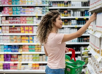 woman shopping for shampoo category