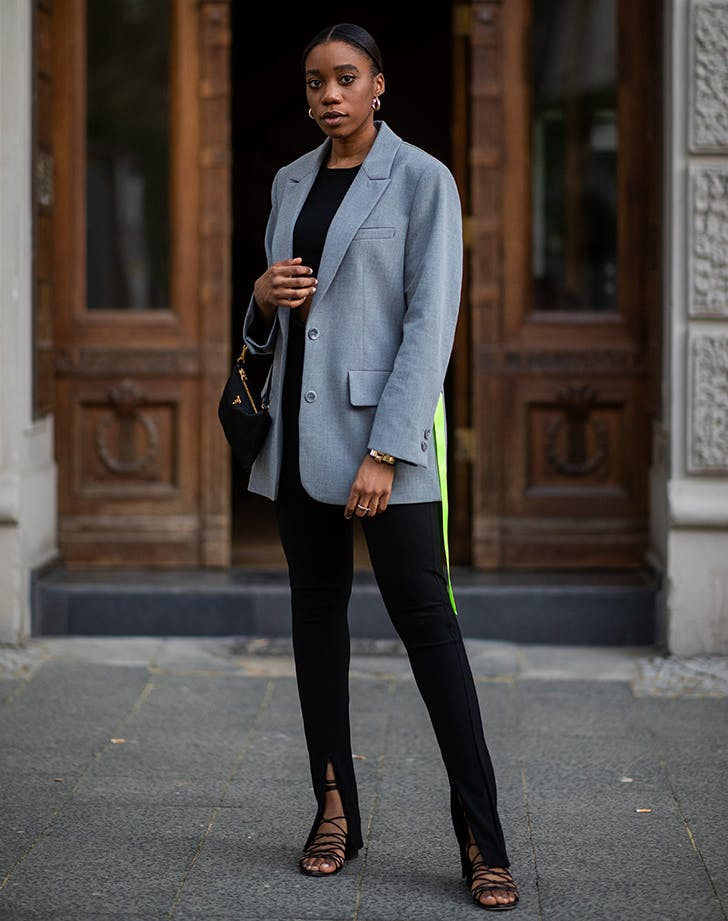 woman wearing a blazer and strappy sandals