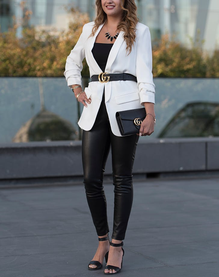 woman wearing a tight cropped blazer and leggings