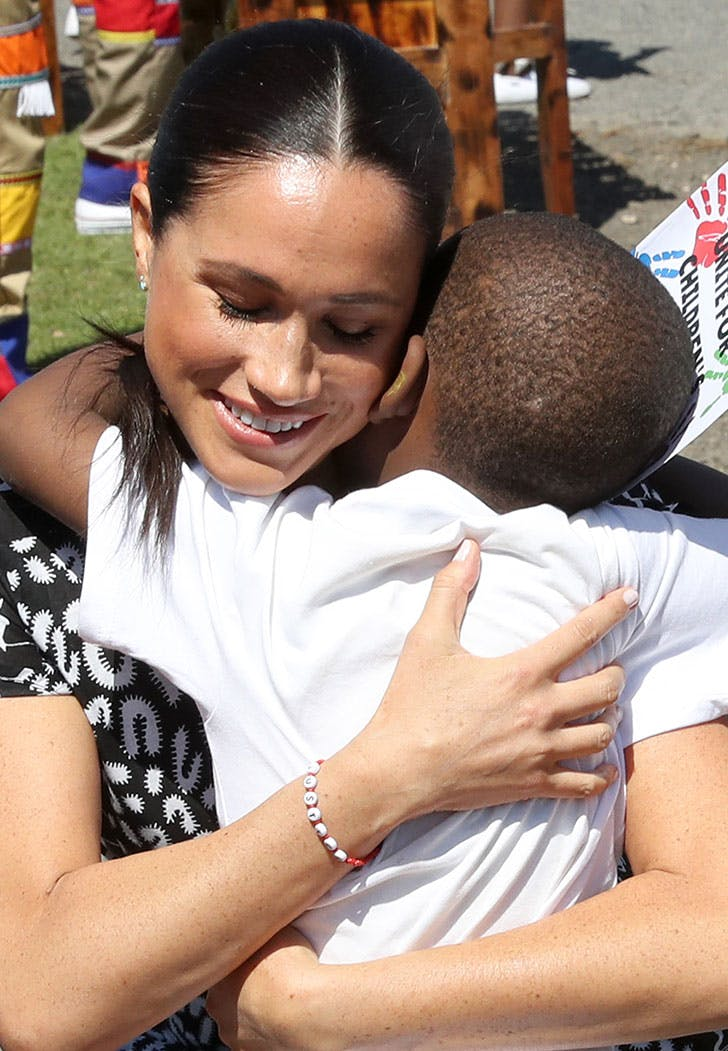meghan markle hugging child bracelet