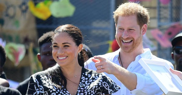This Video of Prince Harry Fixing Meghan Markle's Ponytail Is One of the Best Things We've Seen All Day