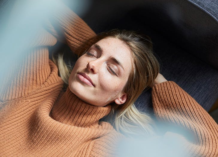 woman lying down with her eyes closed