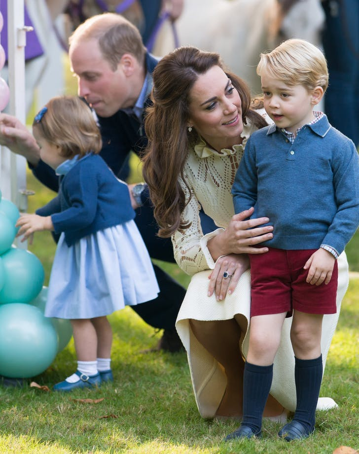 Kate Middleton bending down with Prince George