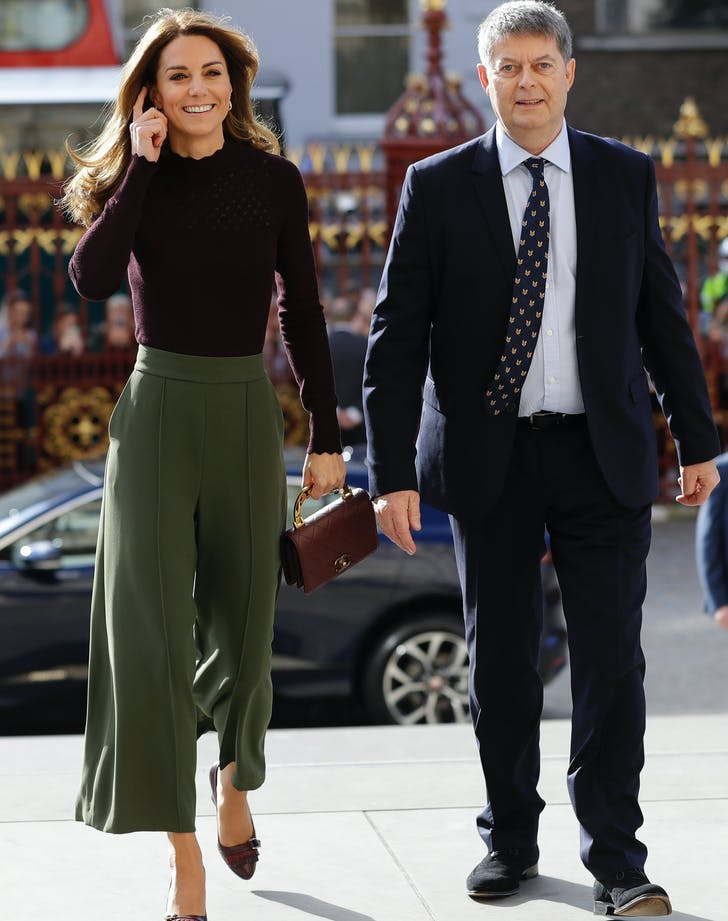 kate middleton wearing burgandy sweater and green culottes