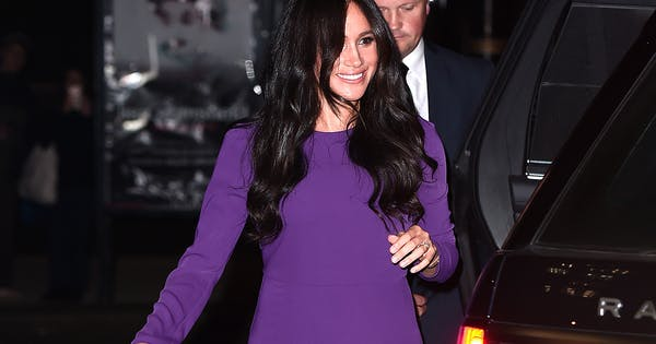 Meghan Markle Dazzles in Purple at Latest Outing, But Leaves Prince Harry at Home