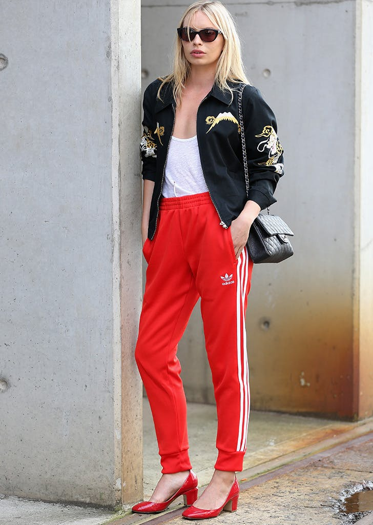 woman wearing red sweatpants and pumps