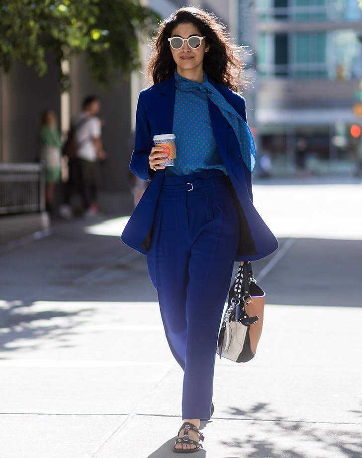 woman wearing a blue suit