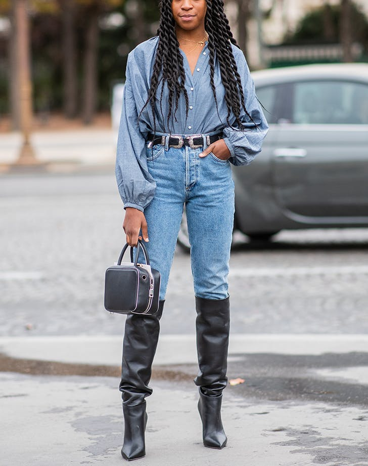 woman wearing skinny jeans and tall boots