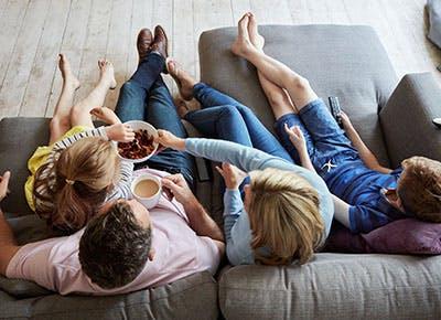 family watching tv cat