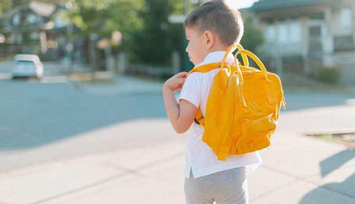 little boy wearing a backpack