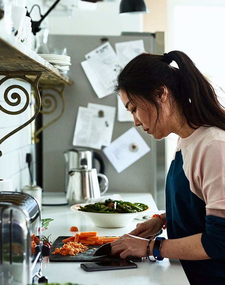 woman cutting carrots in her kitchen