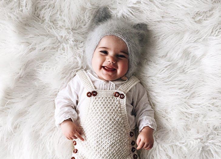 baby girl on rug