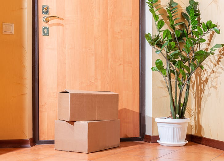 cardboard boxes sitting in a hallway