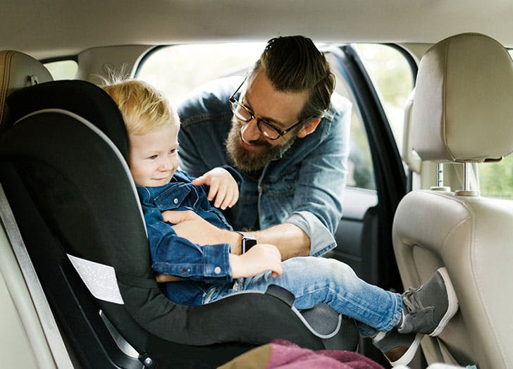 dad kid car seat