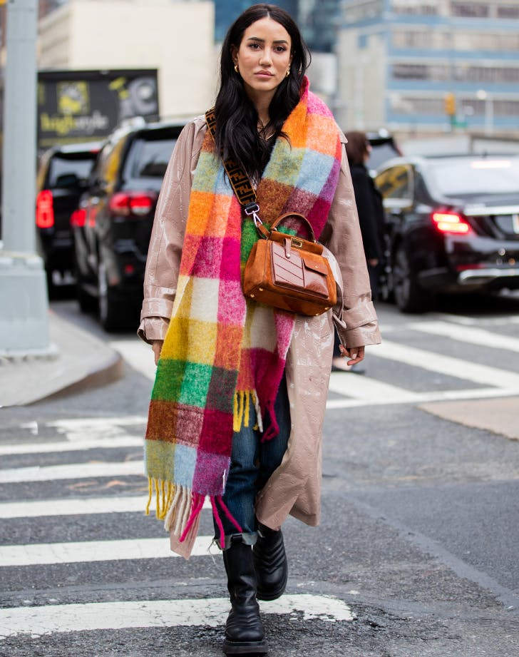 woman wearing a colorful plaid scarf