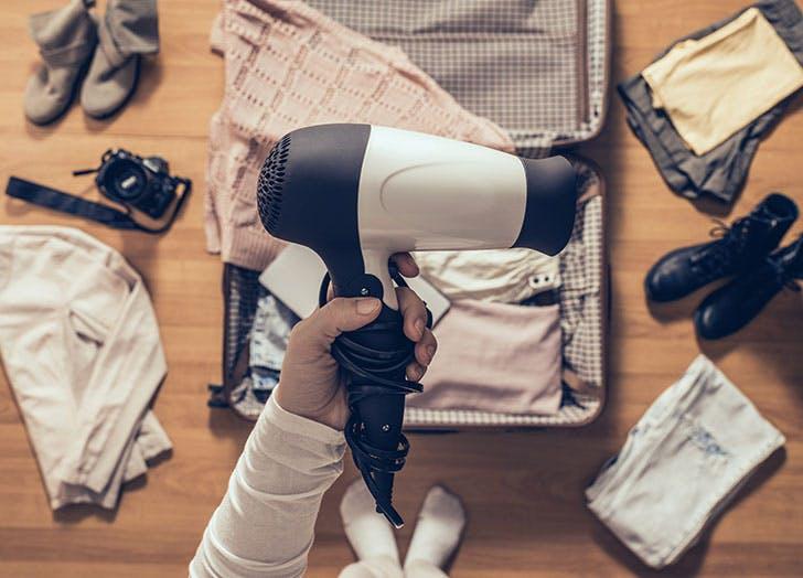 group travel hacks suitcase hair dryer
