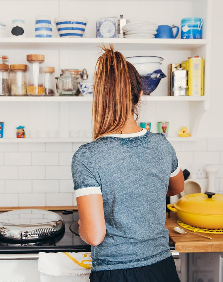woman cooking at her stove