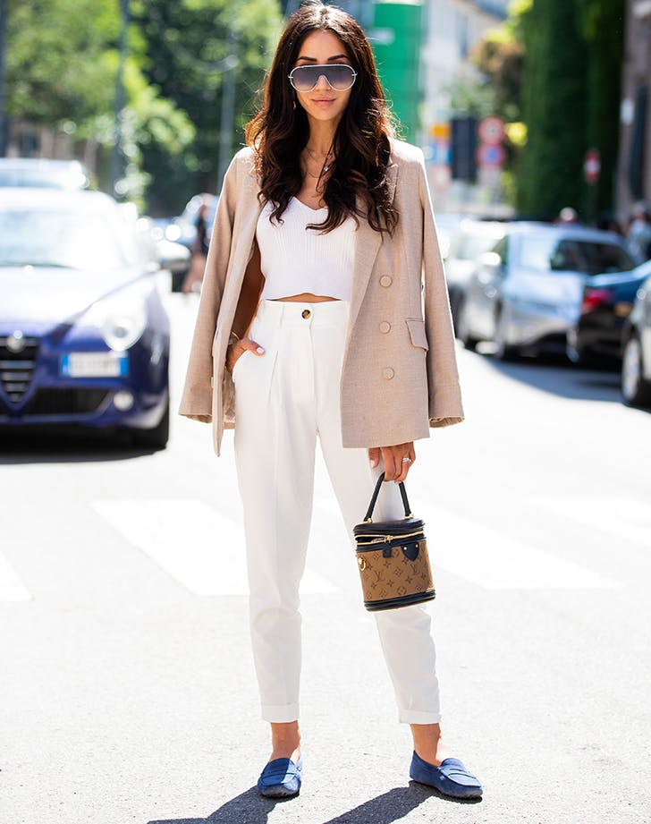 woman wearing white pants and blue loafers