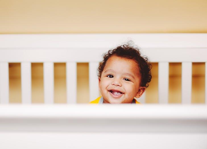 little boy in crib
