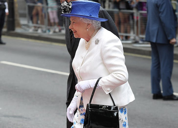 Queen Elizabeth Reportedly Uses Her Handbag to Relay Secret Signals to Her Staff